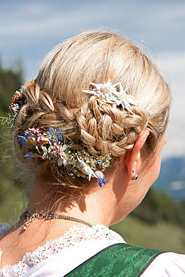 Edelweiss blossoms in the hair - p533m1556546 by Böhm Monika