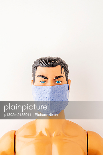 Male toy doll wearing surgical face mask - p1302m2185011 by Richard Nixon