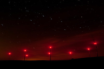 Wind farm at night - p1079m881289 by Ulrich Mertens