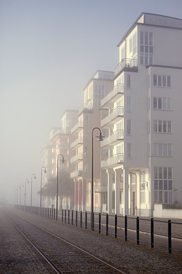 Buildings in fog - p312m1121596f by Dan Lepp