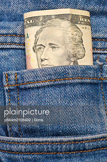 ten american dollar in jeans pocket - p564m2108402 by Dona
