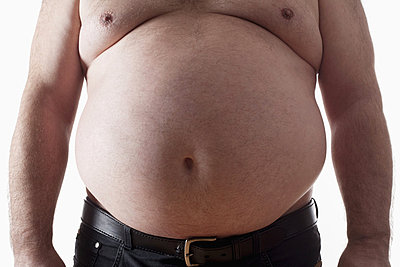 big belly of a fat man isolated on white - p4551505f by Frank Chmura