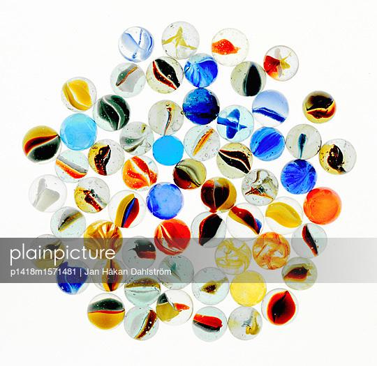 Colourful marbles - p1418m1571481 by Jan Håkan Dahlström