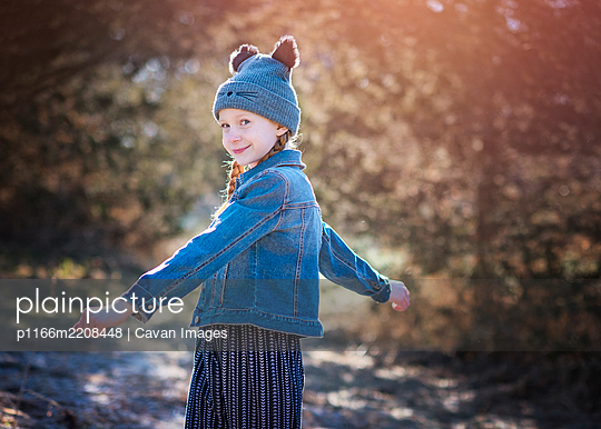 Young Girl Outdoors with Cat Hat - p1166m2208448 by Cavan Images