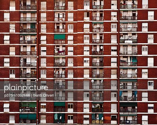Red brick building facade - p378m1002666 by Santi Oliveri