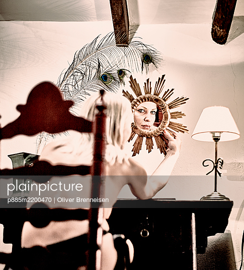 Semi naked woman takes a look in the mirror - p885m2200470 by Oliver Brenneisen