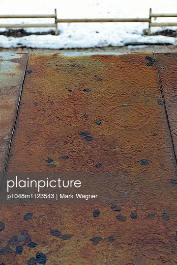 Rain splash on rusty roof - p1048m1123543 by Mark Wagner