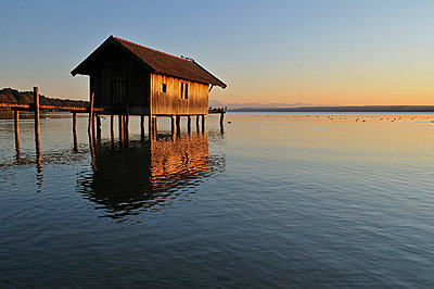 Wooden boathouse in Lake Ammer - p300m700592f by Egmont Strigl