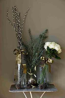 Flower display on a side table - p349m790788 by Polly Eltes