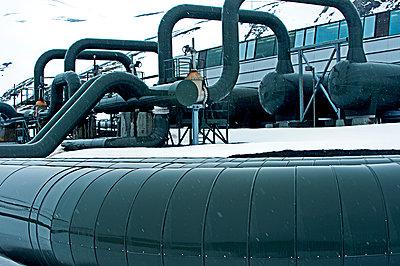 Power plant in arctic landscape - p555m1415722 by Pete Saloutos