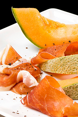 Parma ham and melon - p9249401f by Image Source