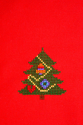 Stitchery on red table cloth - p2480961 by BY