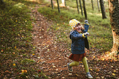 Happy girl in forest - p312m2191109 by Matilda Holmqvist
