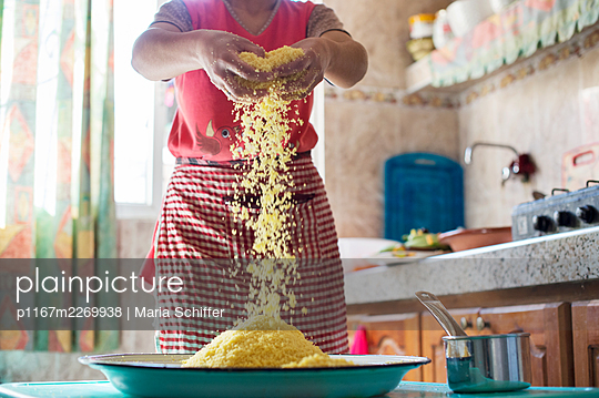 Woman mixing Couscous - p1167m2269938 by Maria Schiffer