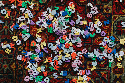 Letter salad scattered on carpet - p1184m1222723 by brabanski