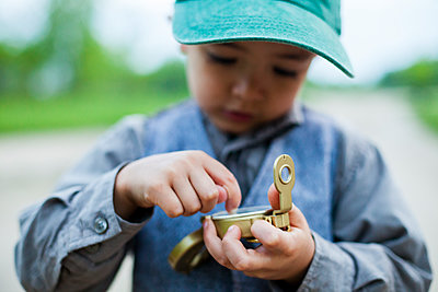 Boy using old compass - p343m1446679 by Steve Glass