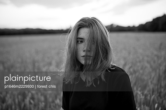 Anxious young woman in a cornfield - p1646m2229930 by Slava Chistyakov