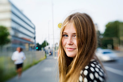Germany, Berlin, Blonde girl (16-17) on street - p352m1126645f by Lena Katarina Johansson