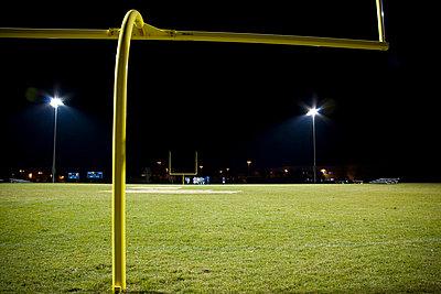 Football field at night - p3722237 by Michael Rastall