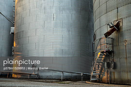Industrial grain silos - p378m1528053 by Marcus Bastel