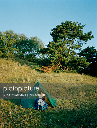 Woman in tent in a meadow, Sweden - p1481m2210504 by Peo Olsson