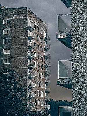 Tower blocks under dark clouds - p1280m2223559 by Dave Wall