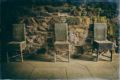 Old wicker chairs row castle room dark spooky - p609m1219847 by OSKARQ
