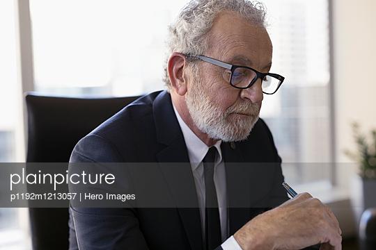 Serious senior male lawyer reading