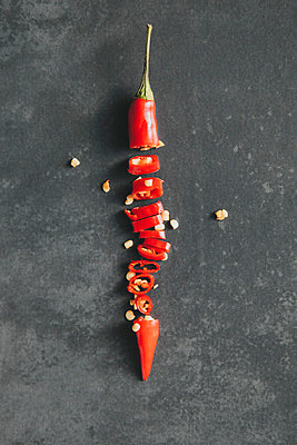 Directly above shot of chopped red chili pepper on table - p301m1029254f by Halfdark