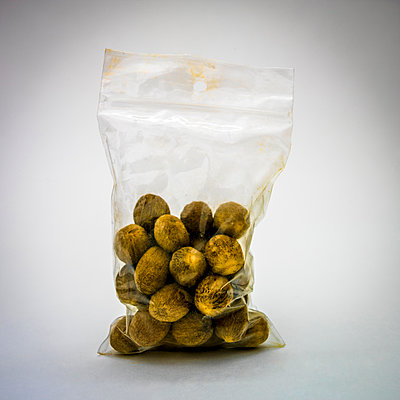Nutmeg in a plastic bag. - p813m1122822 by B.Jaubert