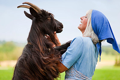 Germany, Bavaria, Mature woman with goat on farm - p300m752373f by hsimages