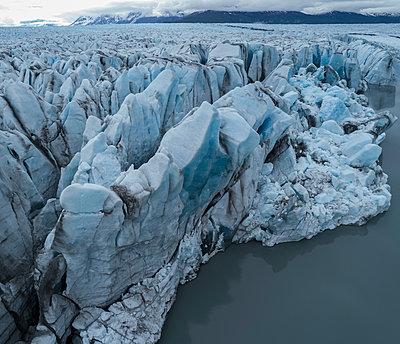 Drone view of glacier in lagoon, Knik Glacier, Palmer, Alaska, USA - p301m1498529 by Stephan Zirwes