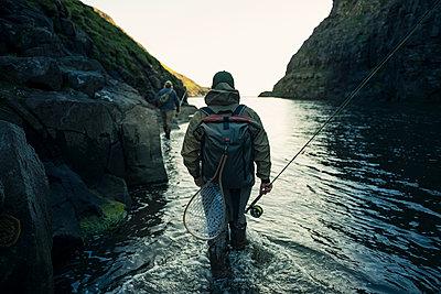 Man walking through river - p312m2120872 by Johner