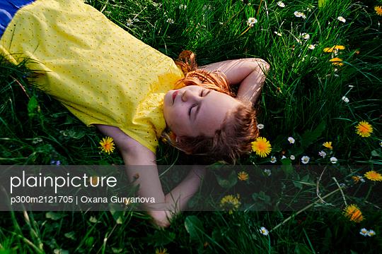 Girl relaxing on flower meadow - p300m2121705 by Oxana Guryanova