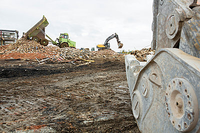 Construction machines and building rubble - p1057m1045140 by Stephen Shepherd