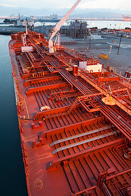 High angle view of deck piping on oil tanker ship - p555m1414145 by Tom Paiva Photography
