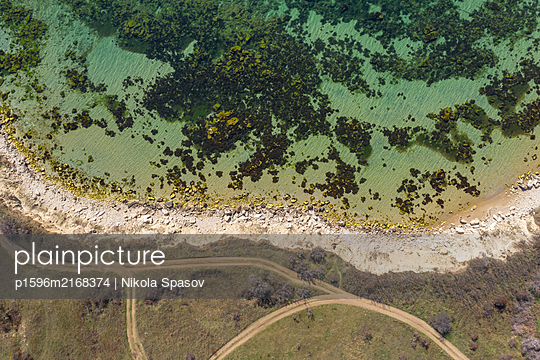 Aerial view of rocky beach and clear turquoise water - p1596m2168374 by Nikola Spasov