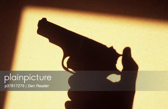 Gun and hand shadow - p37817279 by Den Reader