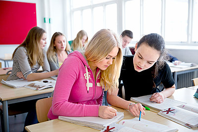 Teenage girls learning in classroom - p312m1407428 by Lena Granefelt