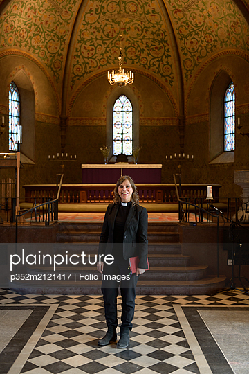 Portrait of priest in church - p352m2121417 by Folio Images