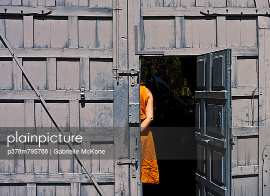 Women in orange dress - p378m795788 by Gabrielle McKone