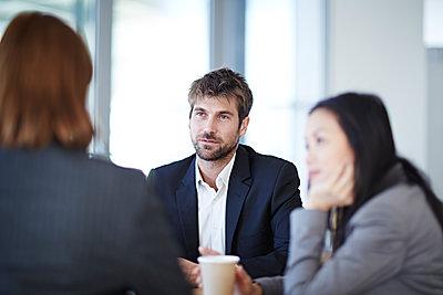 Business people talking in meeting - p1023m1146346 by John Wildgoose