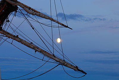 Gibbous moon seen through the rigging of a tall ship - p1072m1056692 by KuS