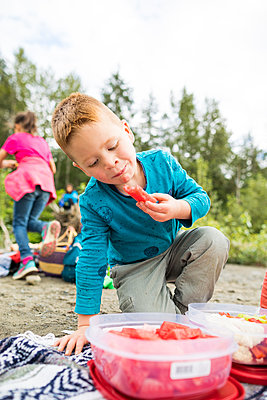Boy eating watermelon - p1166m2201996 by Christopher Kimmel / Alpine Edge Photography