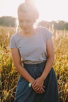Beautiful blonde woman in a field - p1363m1491693 by Valery Skurydin