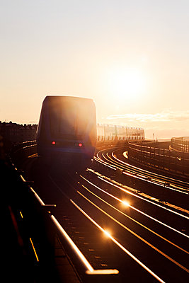 Train at sunset - p312m2092227 by Peter Rutherhagen