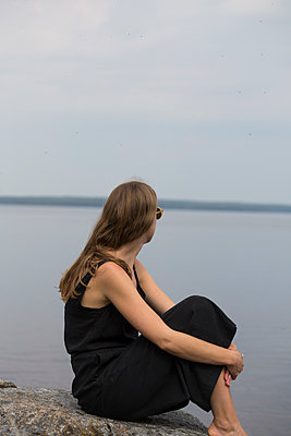 A Young Woman Sitting Alone On The Cliff Looking Over The Sea  - p847m1443850 by Johan Strindberg
