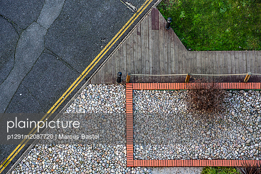 Wooden track and pebble stones - p1291m2087720 by Marcus Bastel