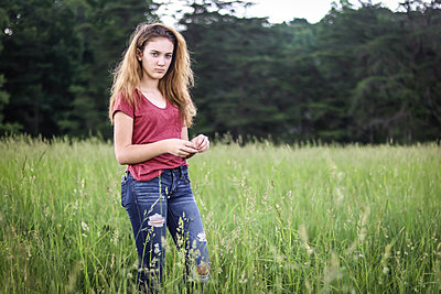 Girl in Grass - p1019m1441877 by Stephen Carroll