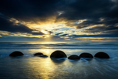 Moeraki Boulders at Sunrise, Otago Coast, New Zealand - p651m2006505 by Tom Mackie